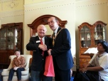 Lord Mayor of Belfast, Ireland, Arder Carson presenting Legal Delegation leader Richard Pena with City Crystal.